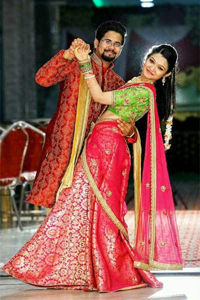 Deepsikha with her Fiance. Deepsikha is wearing the lehenga blouse created at our Bangalore Boutique