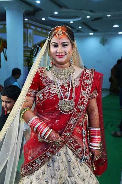 Meenu is wearing a Bridal Lehenga Blouse at her marriage