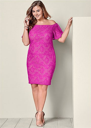 A perfectly fitting single piece dress on a plus size woman