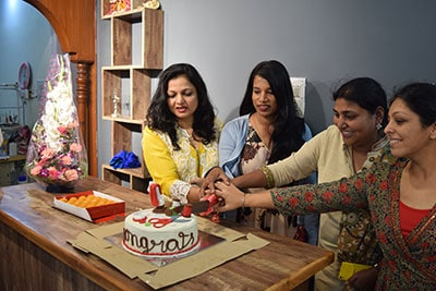 Customers celebrating and cutting cake at the launch of the best designer boutique in bangalore