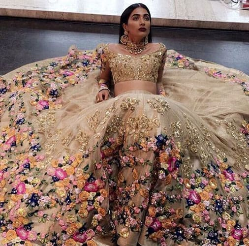 A bride wearing a circular cut lehenga with blouse