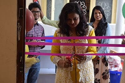 Neeru is cutting the ribbon on the launch of Bangalore's Best Fashion Boutique