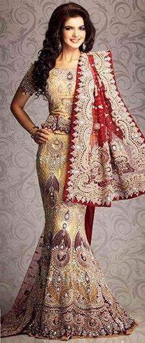 Stylish Maroon colour fish cut lehenga worn by a bride