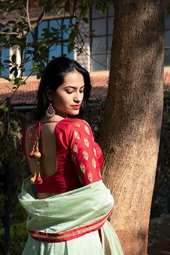 A designer tassel that enhances the overall back design of the blouse