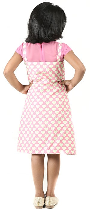 pink frock with pinafore designed and stitched at the boutique