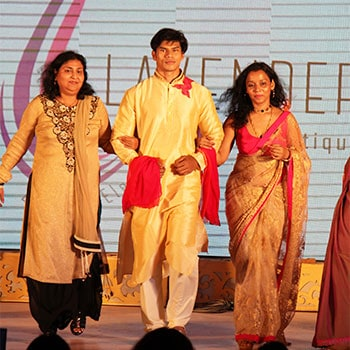 Rashmi Gupta, best fashion designer in bangalore, walks on the ramp at a fashion show