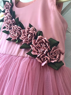 Flowers made by hand using satin cloth beautifully embellished on the kids frock