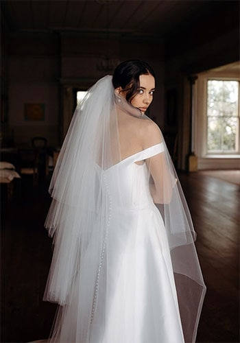 Off the shoulder gown dress back design with multi tiered veil