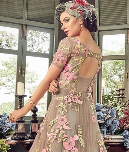 Embroidered Indian anarkali gown paired with a western style birdcage veil