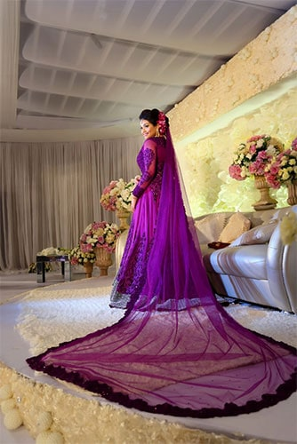 Indo western gown in purple with a cathedral veil doubling up as dupatta