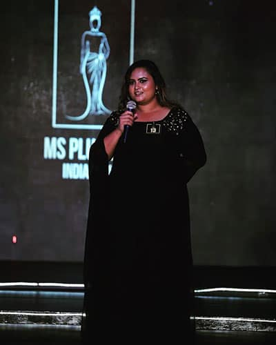 Black evening gown design for plus size model. Long Sleeve inspiration from Sonam Kapoor