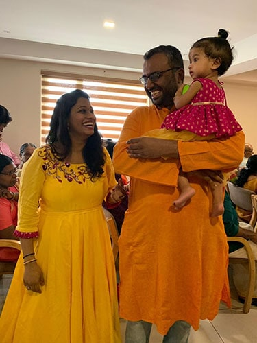Entire family of father, mother & daughter in yellow & pink matching dress