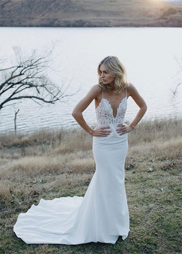 A model wearing a white gown made from crepe fabric