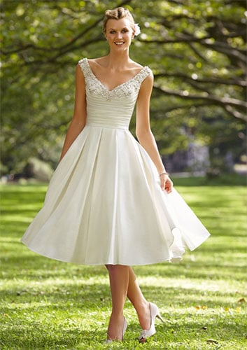 A knee length sleeveless gown with v neckline