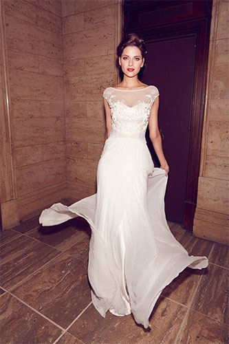 White gown design with illusion neck. Made with chiffon & net fabric