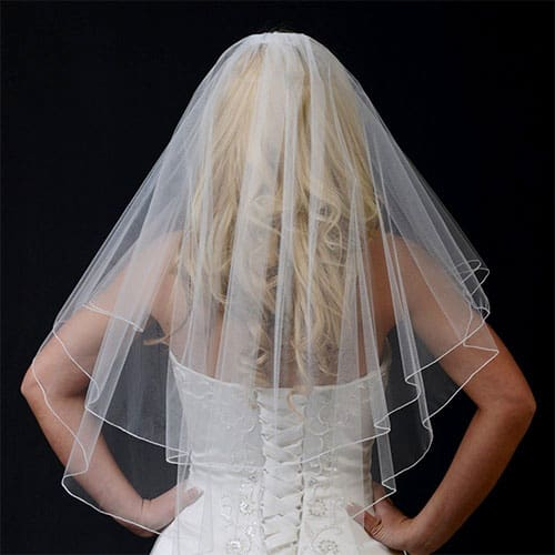 Strapless gown design from the back with a full width veil