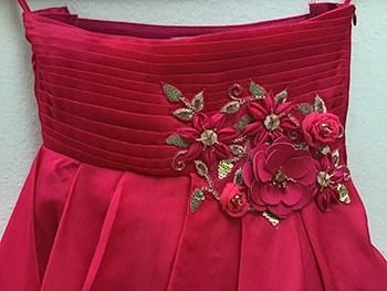 3D embroidery on a red birthday party dress of a kid