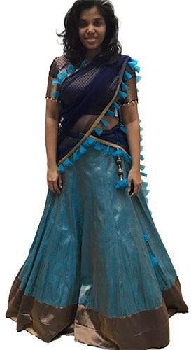Blue silk lehenga with a brown border matching the blouse & black net dupatta
