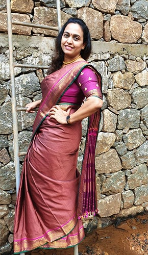 Purple & brown kanjivaram saree paired with a purple blouse embroidered in gold