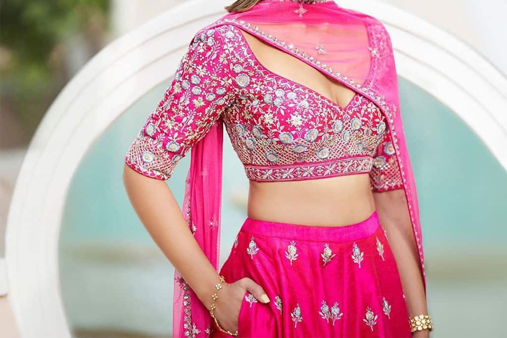 Pink embroidered blouse paired with a modern lehenga skirt
