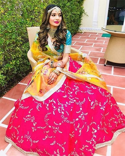 A yellow colour dupatta to style your lehenga dress in red