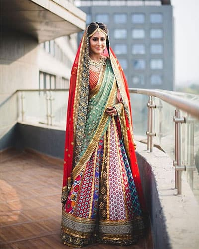 Two dupattas work with a ghagra choli in traditional style