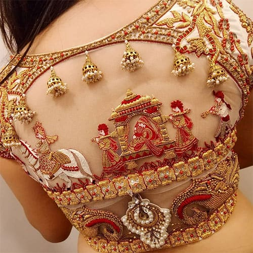 an illusion of the doli of a bride is created on this blouse design for lehenga