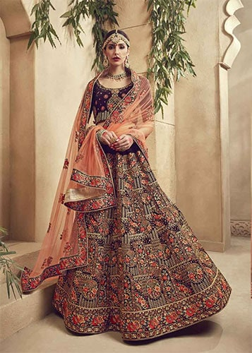 A rajasthani style ghagra choli using multi colour fabrics & threads to embellish the dress