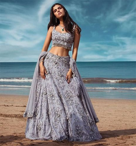 A light blue embroidered lehenga paired with a sleeveless designer blouse