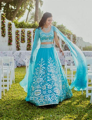 A royal blue ghagra choli design with thread work embroidery in white