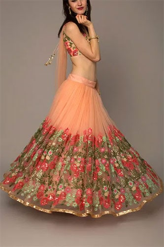 A floral printed lehenga skirt design with a similar print blouse and plain dupatta