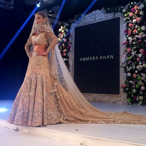 A gown like train is attached to the bridal lehenga design from Designer Ammara Khan
