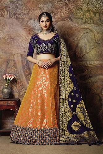 A black dupatta & blouse contrasts the orange colour skirt to style your lehenga dress