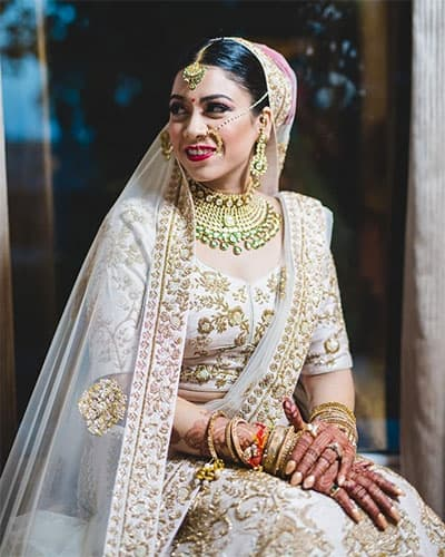 a white dupatta that complements the white lehenga & white blouse.. Embellished with golden colour embroidery