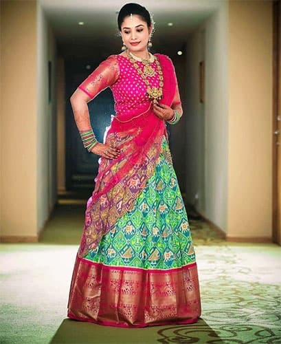 a south indian bride in a lehenga blouse design for the muhurtham ceremony