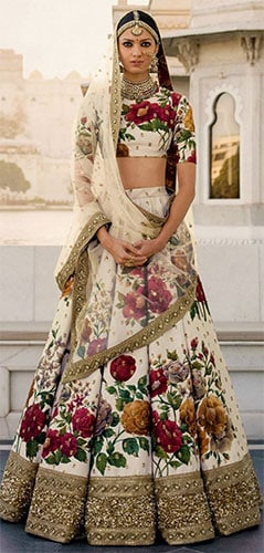 lehenga blouse designs by the ace designer Sabyasachi - skilfully using floral printed fabric for the dress