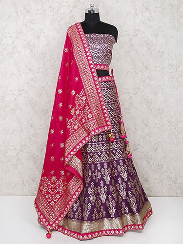 A semi stitched blue lehenga blouse with red dupatta displayed on a mannequin