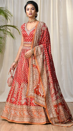 A red lehenga blouse dupatta embellished with gold & silver colour zari embroidery