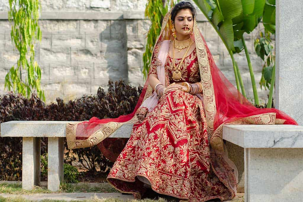 bridal lehenga blouse in striking red colour from the boutique