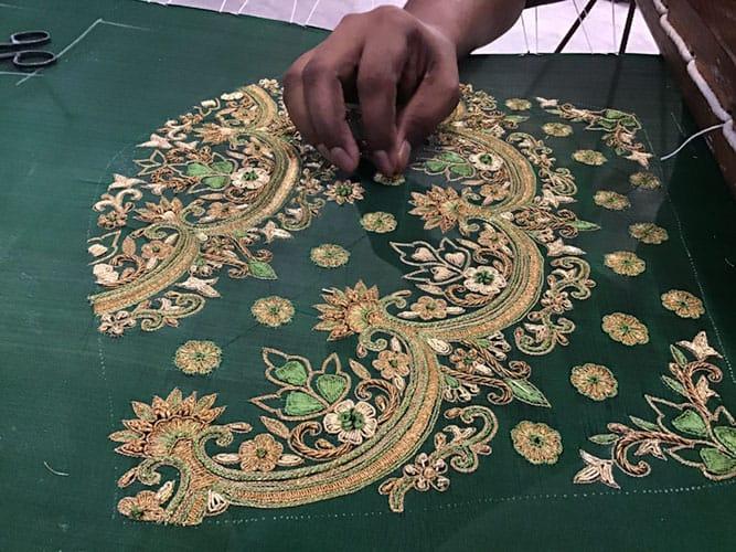 hand embroidery work on green lehenga skirt