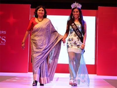 Designer Rashmi Gupta walking the ramp with Mrs Earth winner